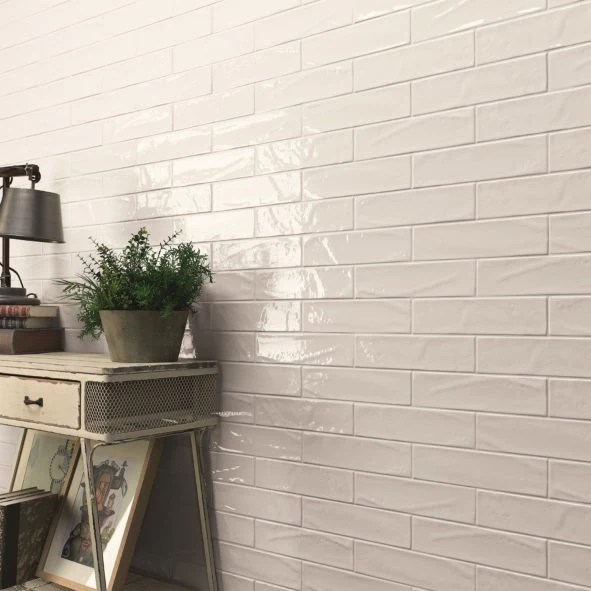 glossy ceramic 3 x12 subway tile in textured white or light beige