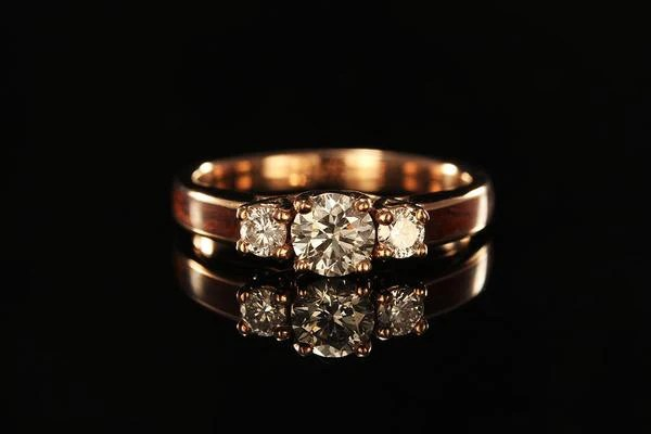 Women S Wooden Engagement Ring With 14k Rose Gold Chasing Victory