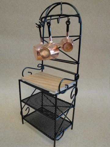 bakers rack with pots