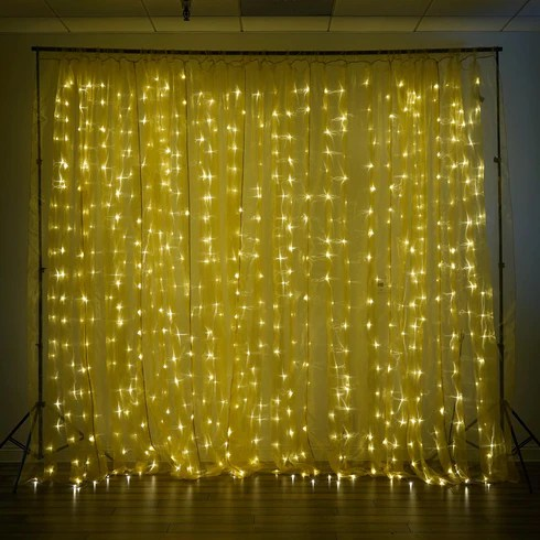 20ft x 10ft sheer gold curtain backdrop with 600 warm white led lights