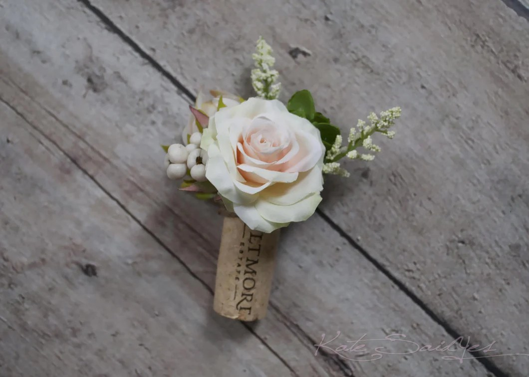 Peach Rose And Succulent Boutonniere