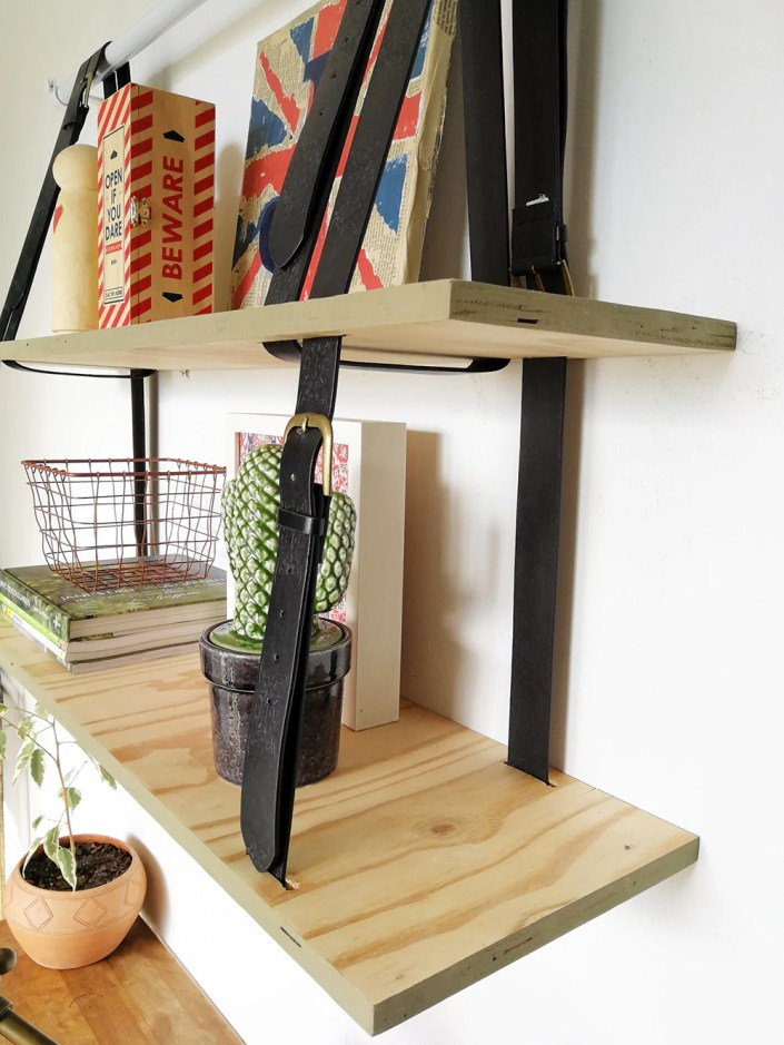 diy hanging shelf in home office with black belt and bronze detail