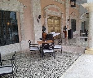 cement tile border pattern creates cozy