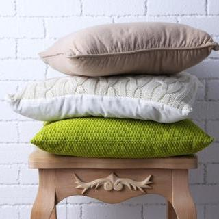 a sofa or bed with cushions
