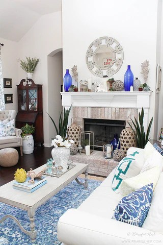 like i said the coastal display made me swoon take a look at my finds and get my styling tips to design a coastal mantel for yourself below
