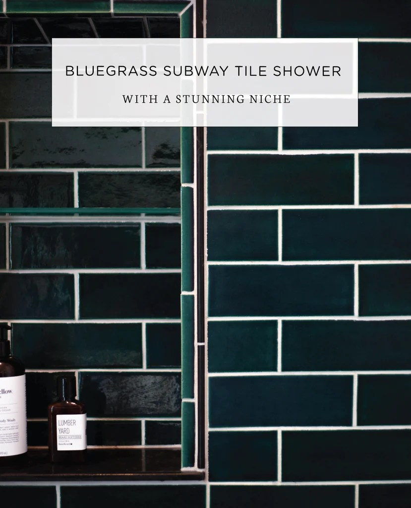 teal subway tile shower with a stunning
