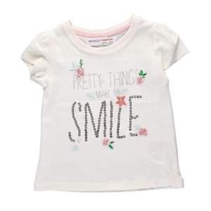 Tricou paiete si flori copii fete: tricou din bumbac, cu mesaj imprimat cu paiete si floricele cusute. Mărimi pentru 12 luni-3 ani. Culori: alb și roz. Compoziție: 100% bumbac.