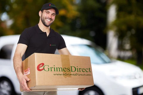 Grimes employee delivering product to customer.  Grimes Branding is displayed.