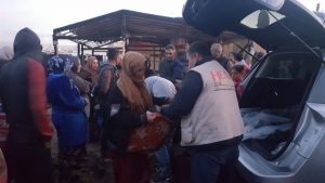 HFL_delivering aid to tent fire victims