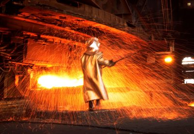A worker processes nickel, Sulawesi, Indonesia, 8 January 2014 (Photo: Reuters/Yusuf Ahmad).