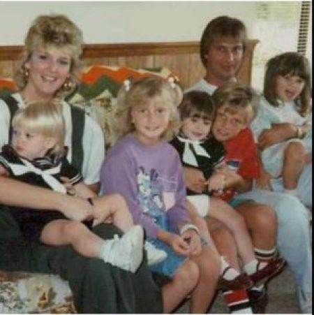 Angel with her family, mother, father and four siblings at early age.