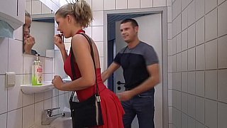 Lady_in_Red_gets_her_ass_fucked_in_Toilet._Swallow image