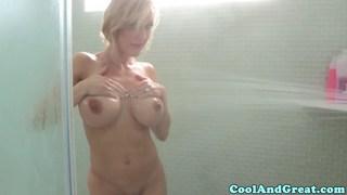 Busty milf masturbates in shower image