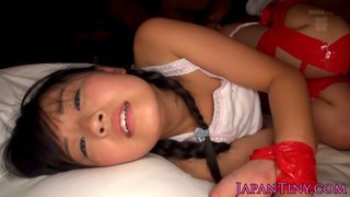 Tiny Japanese babes tied up and fucked by two dude image