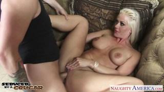 Blonde cougar Holly Heart sucking a big shaft image