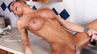 Sexy athletic mom uses the kitchen sink to cum image