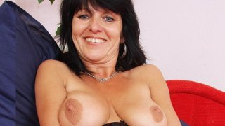 Hot cougar shows off her natural tits and pussy image