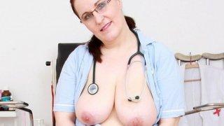 Image: Huge breasted older medic specula self-exam