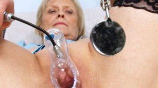 Image: Blonde granny nurse self exam with pussy spreader