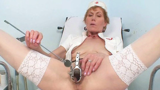 Image: Old mom self exam on gynochair with speculum