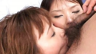 Image: Two_horny_Japanese_sluts_fuck_an_uncut_cock_and_share_a_hot_jizz_cocktail