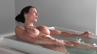 Kendra Lust taking a hot bath and playing with her pussy image