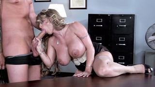Holly Halston bent over while giving a blowjob in the office image