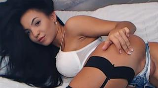 Busty Latina fingering and dildoing her pussy image
