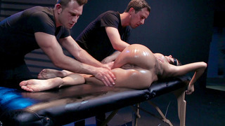 Blindfolded Peta Jensen getting her body oiled by two horny guys image