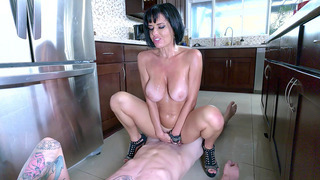Veronica_Avluv_wearing_nothing_but_high_heels_rides_him_in_the_kitchen image