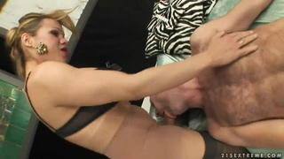 Blonde shemale Mireira dominates over tall lover image