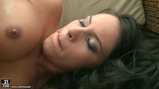 Brunette Amabella lotions her asshole and slowly shoves a black dildo in it image