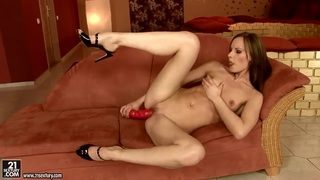 Image: Gitta Blond fucks her pusy with a red sex toy