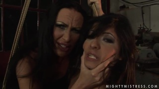 Image: Lesbian BDSM scene with hot brunettes named Mandy Bright and Oliva
