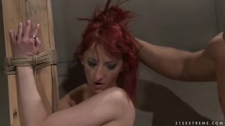 Pretty slender redhead girl Krisztin got tied up to the column by her boyfriend and getting hardly fucked by him. image