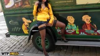 Leggy brunette seduced to masturbate in park image
