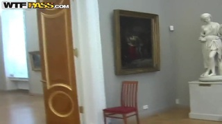 Hot sucking action by young couple right in the museum image
