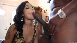 Skin Diamond wraps her moist lips round a massive dick image