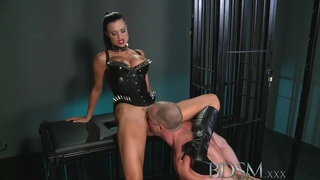 BDSM XXX Muscular sub is caged and humiliated image