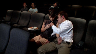 Naughty Blowjob In The Movie Theater image