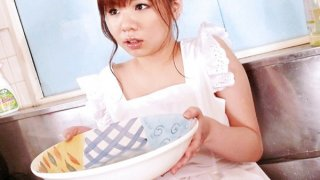 Aoi in the kitchen sink her big tits oiled up and squeezed before fucking a dick with her tits image