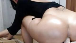 Big ass milf nice riding dildo on table image