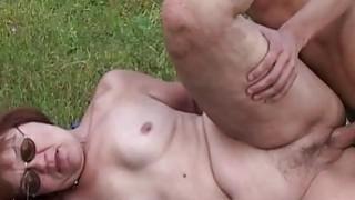 Horny Farm Boy Fucks A Redhead Mature Outdoors image