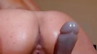Latina with big butt riding big dildo on webcam image