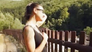 Busty teen strokes outdoors for cash image