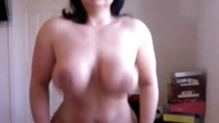 Brunette Busty milf deep riding dildo on webcam image