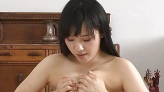 Japanese darling mesmerizes with titty fucking image