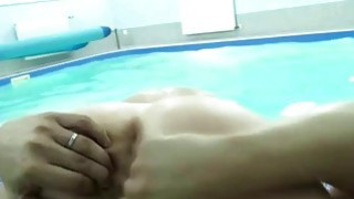 Amateur swingers group sex party in swimming pool image