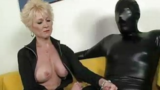 Dressed In Black Big Titted Granny Examines Cock image