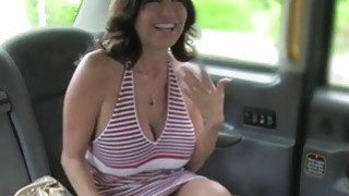Sexy Milf flashing huge tits in a fake taxi image